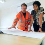 engineers-looking-at-blueprint-3862135