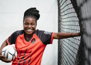 young-happy-black-woman-football-player-with-ball-in-hand-3886089
